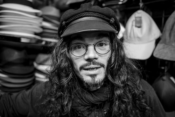 Man in hat shop