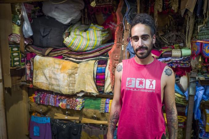 Man in rug shop colour